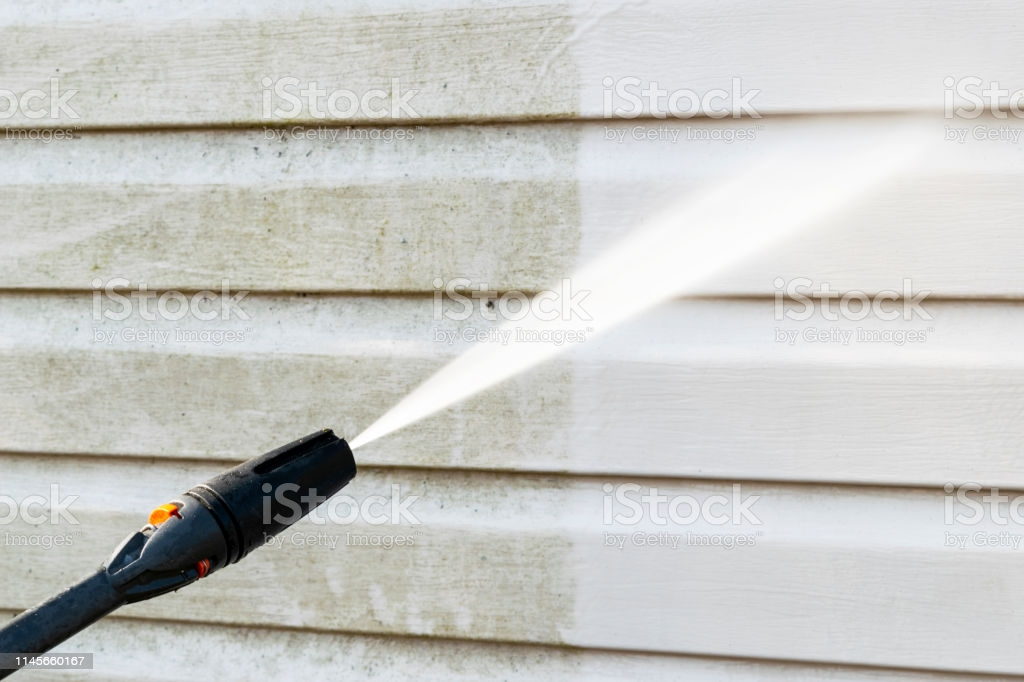 power washer cleaning wall